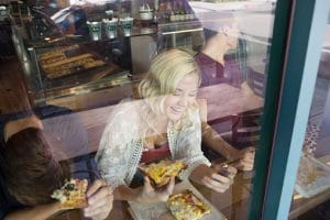 woman-eating-pizza-620920541